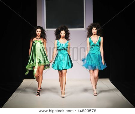 young beautiful model walking on fashion show piste