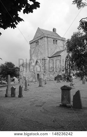 A view across a graveyard to Crichton collegiate church