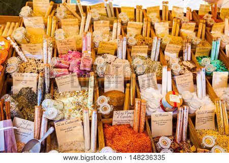 NICE, FRANCE - AUGUST 28, 2016: Counter in the market with flavored salt in Nice, France. Many different flavors of salt piled in wooden container. Provence