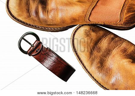 Leather shoes and belt on a white background.