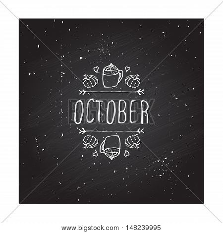 Hand-sketched typographic element with pumpkins, hearts, pumpkin spice latte and text on blackboard background. October