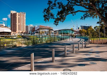Adelaide Australia - September 11 2016: Adelaide city skyline viewed across the foot bridge in Elder Park on a bright day