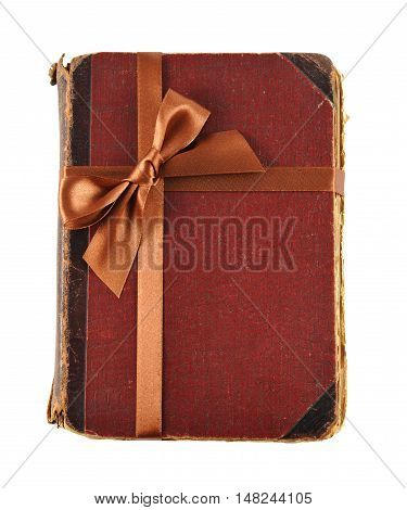 Closed old book with bow isolated on white background
