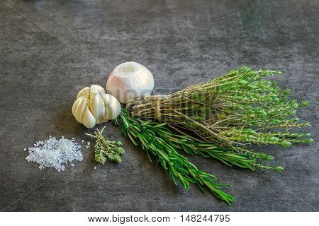Spices: rosemary thyme sea salt garlic and onions. Concept - healthy food.