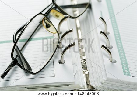 white Sheets organizer closeup metal decompression clamp