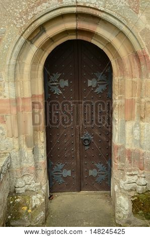 A view of an ornate door at Crichton collegiate church