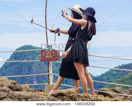 Semporna,Sabah-Sep 10,2016:Tourists enjoying amazing view from viewpoint National Park on top of Bohey Dulang island Semporna,Sabah.The bright blue water & rocky shore in the island of Semporna