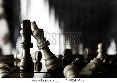 Kings Chess pieces standing on a chessboard.Soft focus