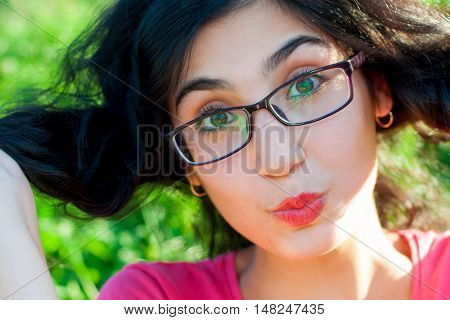 portrait of a girl with glasses in the summer on the nature
