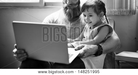 Father Daughter Using Device Concept