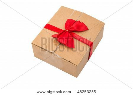 small gift box wraped in recycled paper with ribbon bow isolated