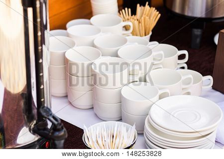 Many Rows Of White Ceramic Coffee Or Tea Cups