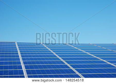 solar panels under blue sky in summer