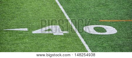 The 40-yard-line of an american football field with artificial turf