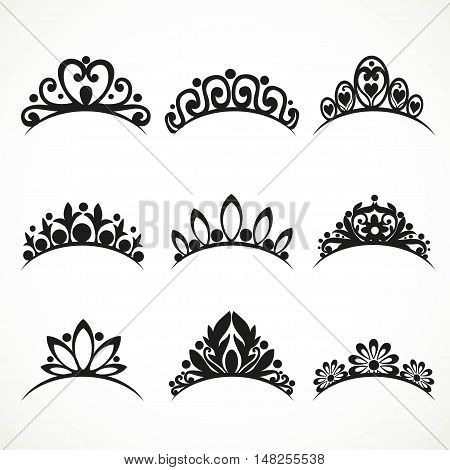 Silhouettes of tiaras of various shapes with flowers and hearts on a white background