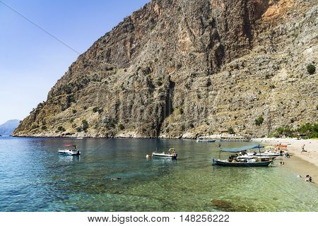 BUTTERFLY VALLEY BEACH TURKEY - JUNE 01: Tourists visit famous Butterfly Valley beach near Oludeniz in Turkey on JUNE 01 2016. Butterfly Valley beach is one of the best beaches in Turkey