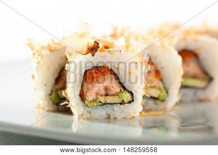Salmon Skin Maki Sushi - Roll with Salmon Skin, Cucumber and Avocado inside. Grilled Sliced Tuna outside