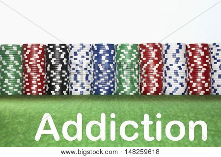 Stacks of Gambling Chips with text saying Addiction