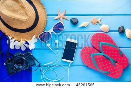 accessories for summer on blue wooden floor