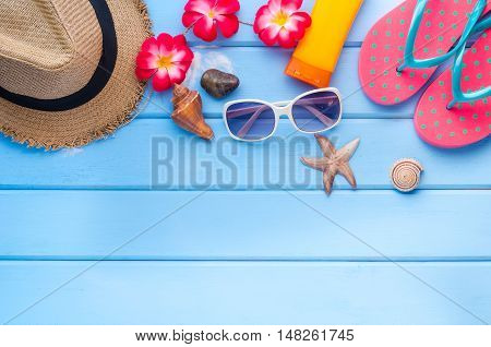 accesories for summer on blue wooden floor