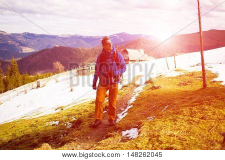 Hiker With Backpack Goes On The Track.