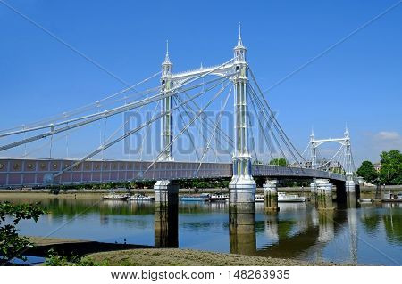 Opened 1874, the Albert Bridge over the river Thames in London connects Chelsea on the North bank to Battersea on the South bank.
