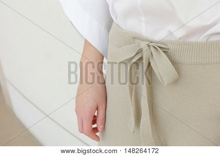 Beige draw string waist casual woman pants style close up details. Minimal trendy fashion.
