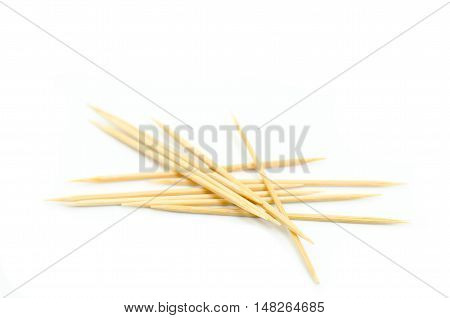 Many wooden toothpicks isolated on white background
