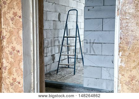 Stepladder in the room during capital repair