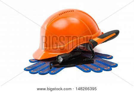 Construction helmet with steel trowel and gloves on white