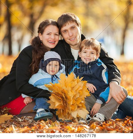 Happy family in the autumn park