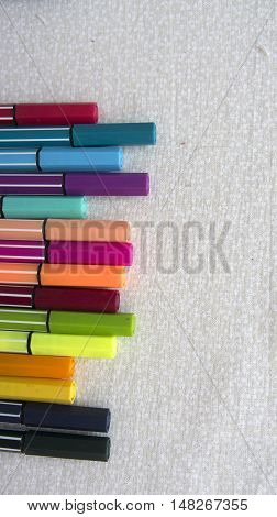 Markers aligned cheerful colors on neutral background