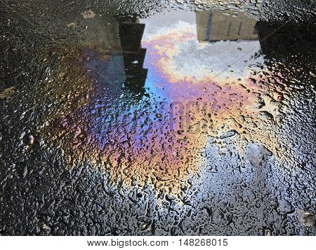Puddle of oil and water on asphalt