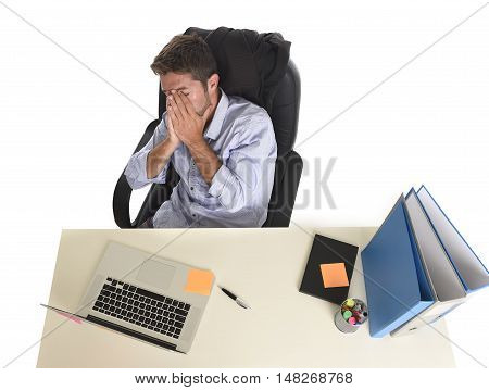 tired and frustrated businessman looking worried face expression suffering stress at office laptop computer having work problem sitting on desk with paperwork isolated on white background