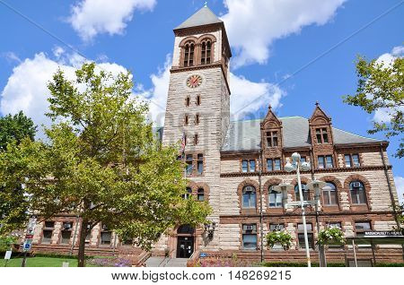 Cambridge City Hall located at 795 Massachusetts Avenue, and built in the Richardsonian Romanesque style in Cambridge, Massachusetts, USA