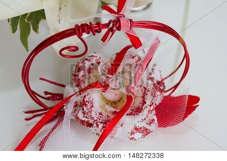 Wedding rings in a red support for the wedding day