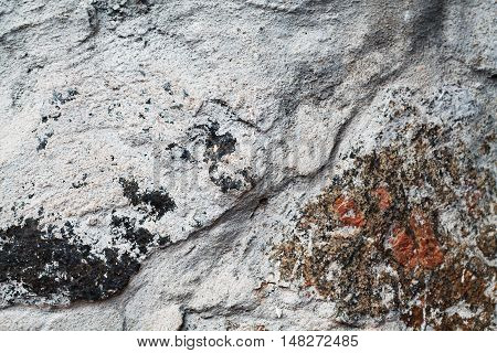 Scabrous gray natural stone texture floor, background, surface, closeup,