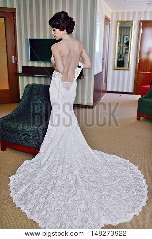 Beautiful Bride In Lingerie Is Wearing A Wedding Dress. Beauty Model Girl In White Underwear. Female