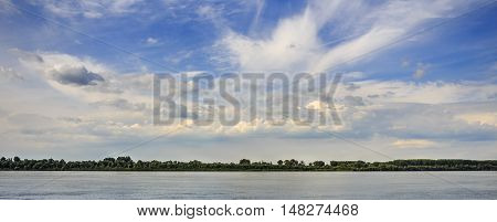 River Danube and blue cloudy sky above it