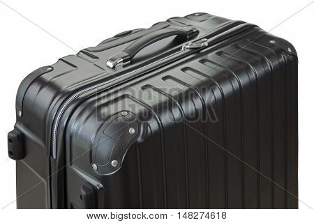Side view of a big lightweight hard shelled suitcase focus of bumper, new and clean luggage in black color made of Polycarbonate material isolated on white background