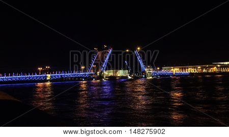Night view of Neva River and raised Palace Bridge in St. Petersburg Russia