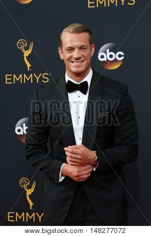 LOS ANGELES - SEP 18:  Joel Kinnaman at the 2016 Primetime Emmy Awards - Arrivals at the Microsoft Theater on September 18, 2016 in Los Angeles, CA