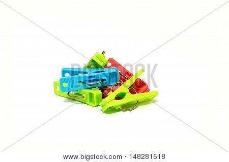 Stack of colorful plastic clothespin on white background