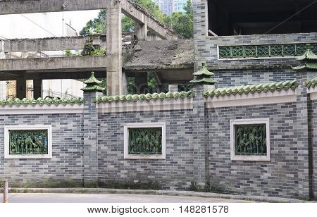 A chinese style wall and weathered building frame in the City of Guangzhou China.