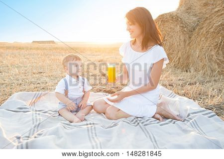 Mother And Her Son On Holiday At A Picnic.