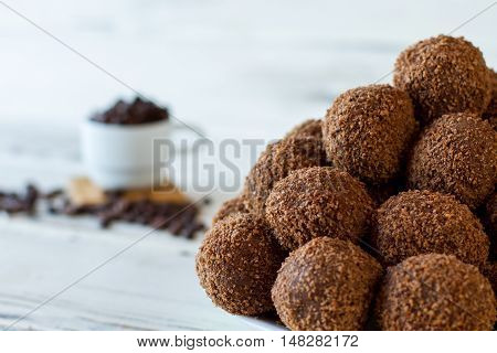 Small desserts with crumbs. Pile of brown sweets. Best recipe of chocolate balls. Biscuits mixed with butter.