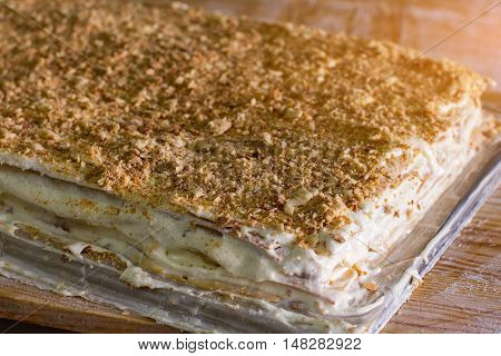 Layered dessert with cream. Lots of biscuit crumbs. Easy recipe of millefeuille. Freshly made cake.