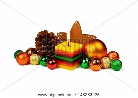 Christmas arrangement in a rustic style with a burning candle isolated on white background.