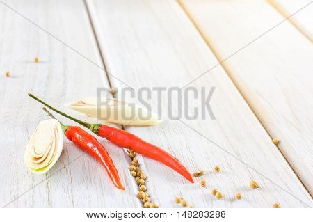 red chillies pepper on the white wooden floor.