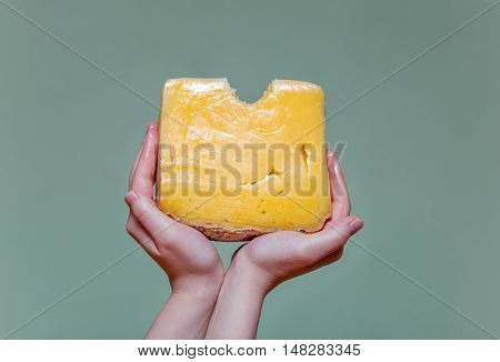 Two Arms Holding Cheese